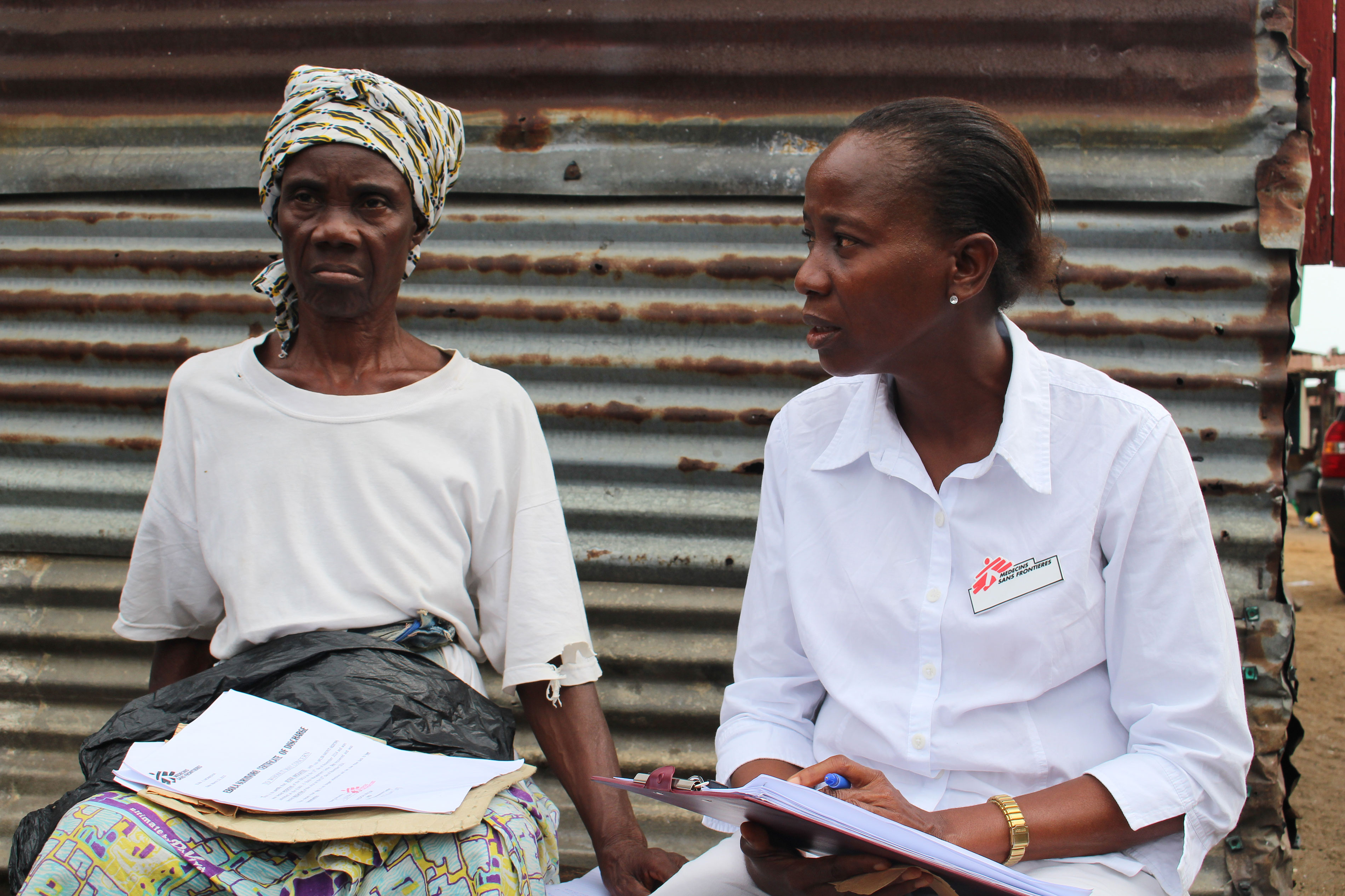Ebola survivor, Jesse Wolatee, 65yrs, explains to an MSF Ebola survivor clinic staff post-Ebola syndrome she is experiencing.