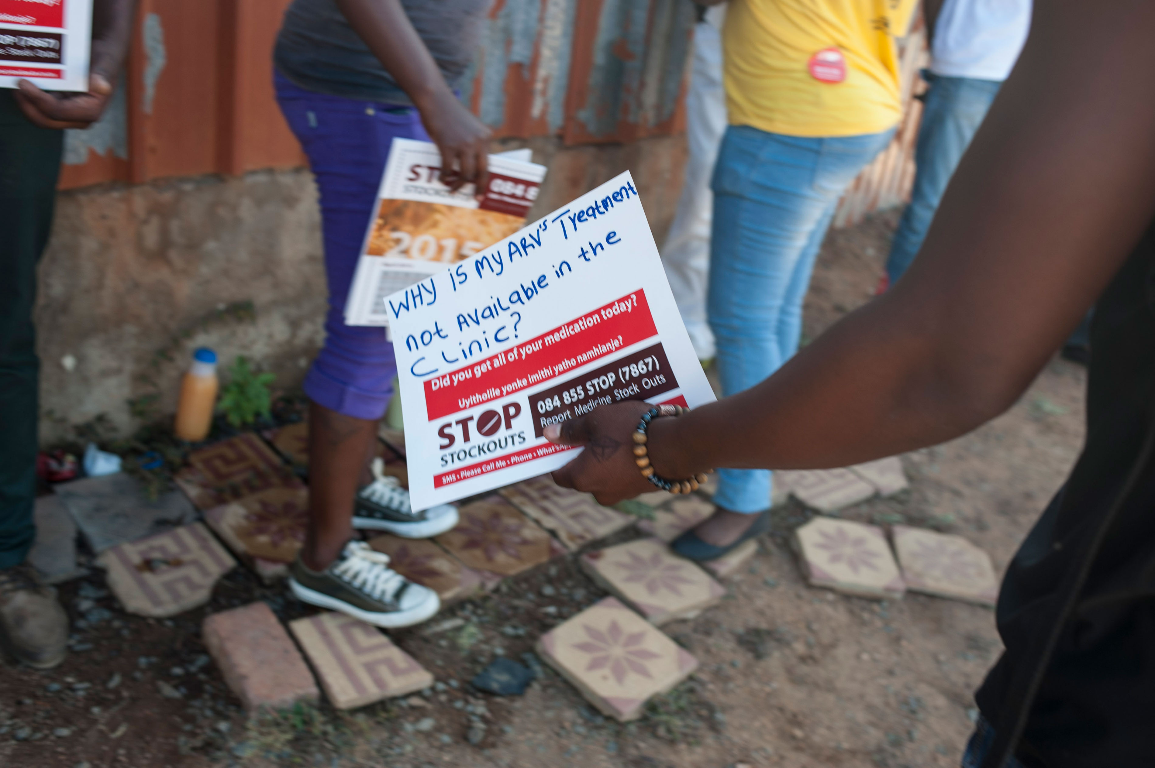 A woman holds a sign at the Stop Stock Outs (SSP) activist meeting in Soshanguve, a township outside of Pretoria on April 16, 2015.