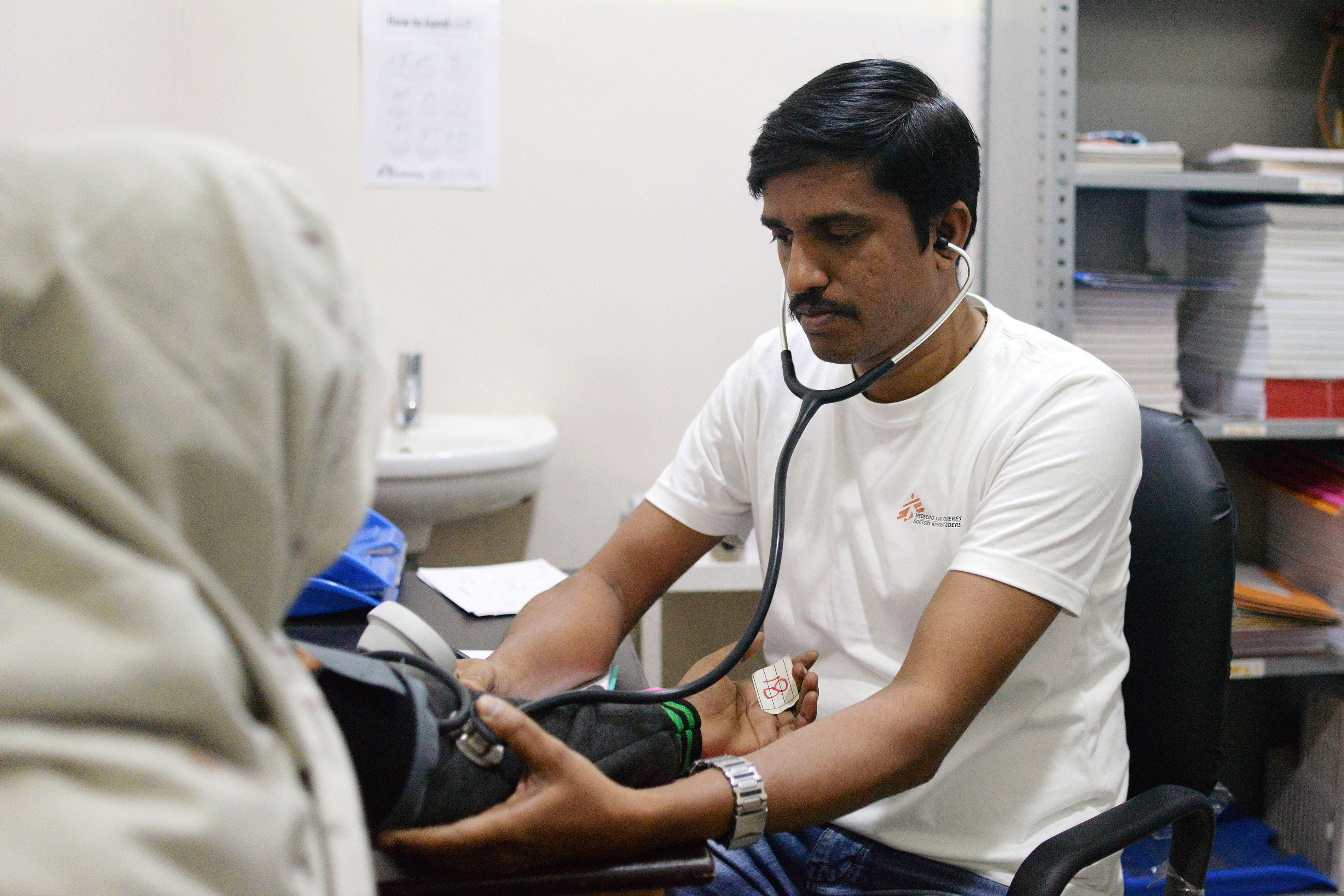 MSF Nurse Jijo Xavier checks the vitals of a patient at the PL Sharma District Hospital in Meerut city where MSF runs a Hepatitis C project in collaboration with the National Health Mission, providing free services.