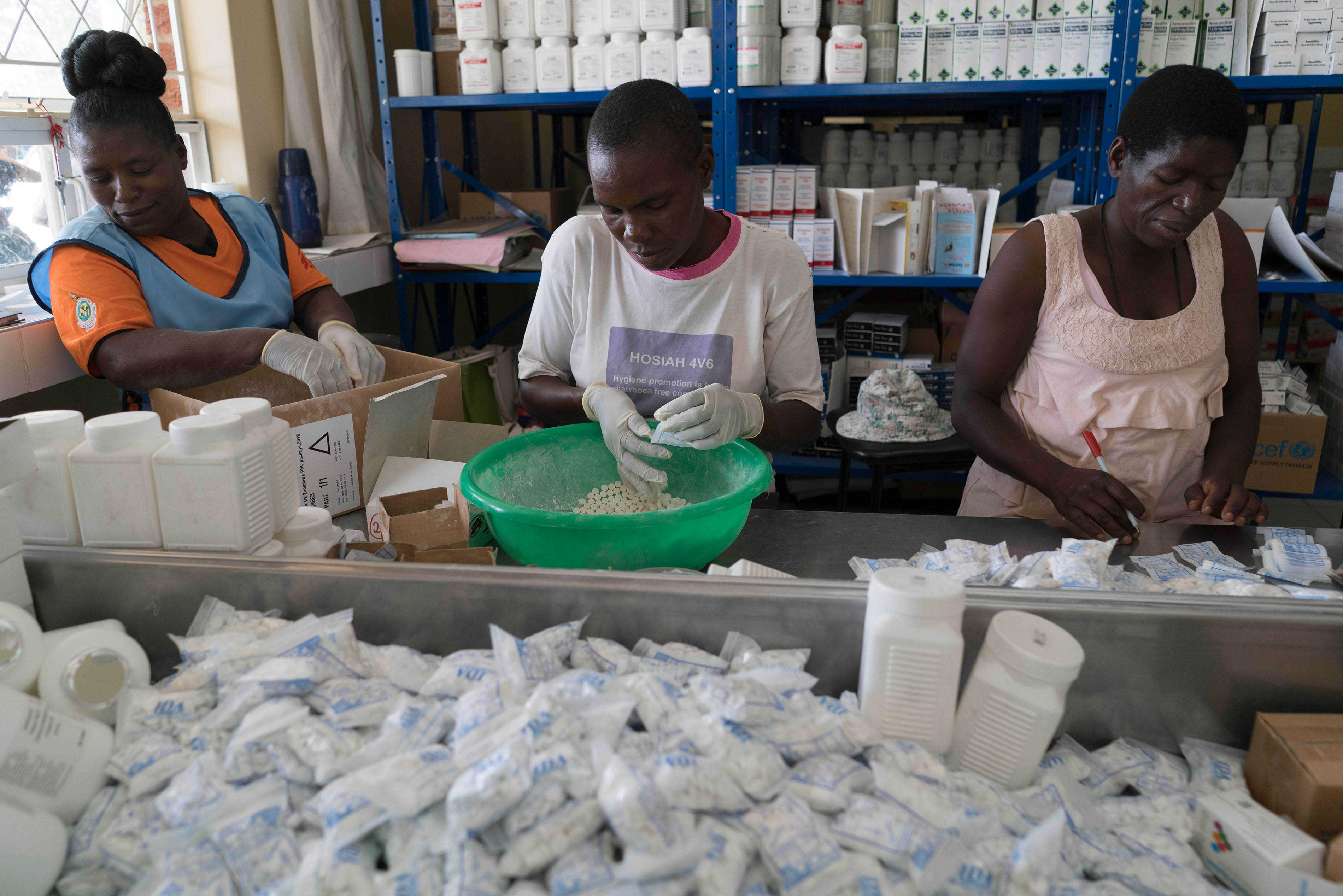 MSF trained staff pack bags of medication for TB and HIV patients at the pharmacy at Epworth Clinic, on Harare's outskirts.