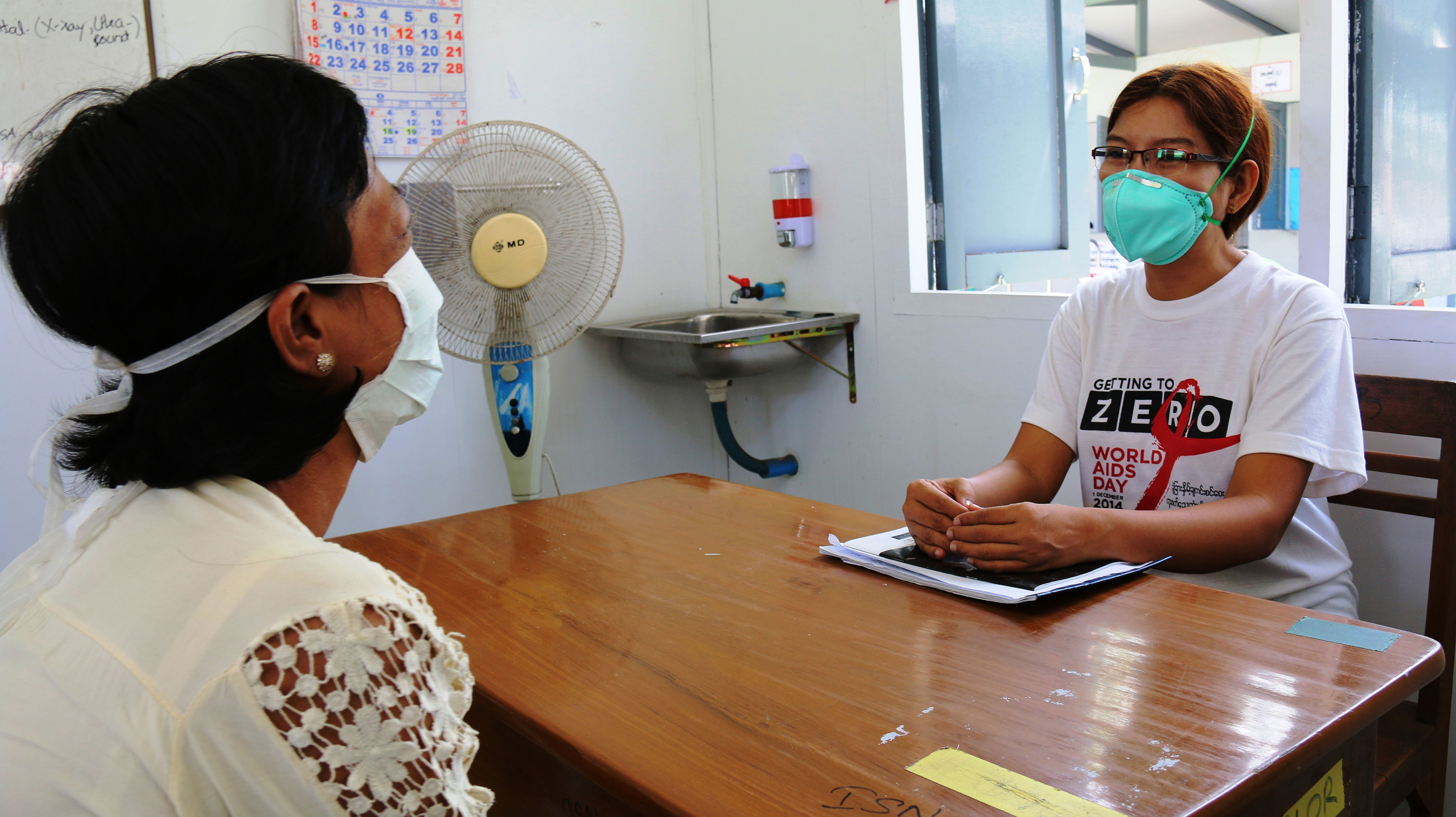 MSF staff conducts a medical consultation with a female MDR-TB patient at MSF's Insein Prison clinic, Yangon, Myanmar.