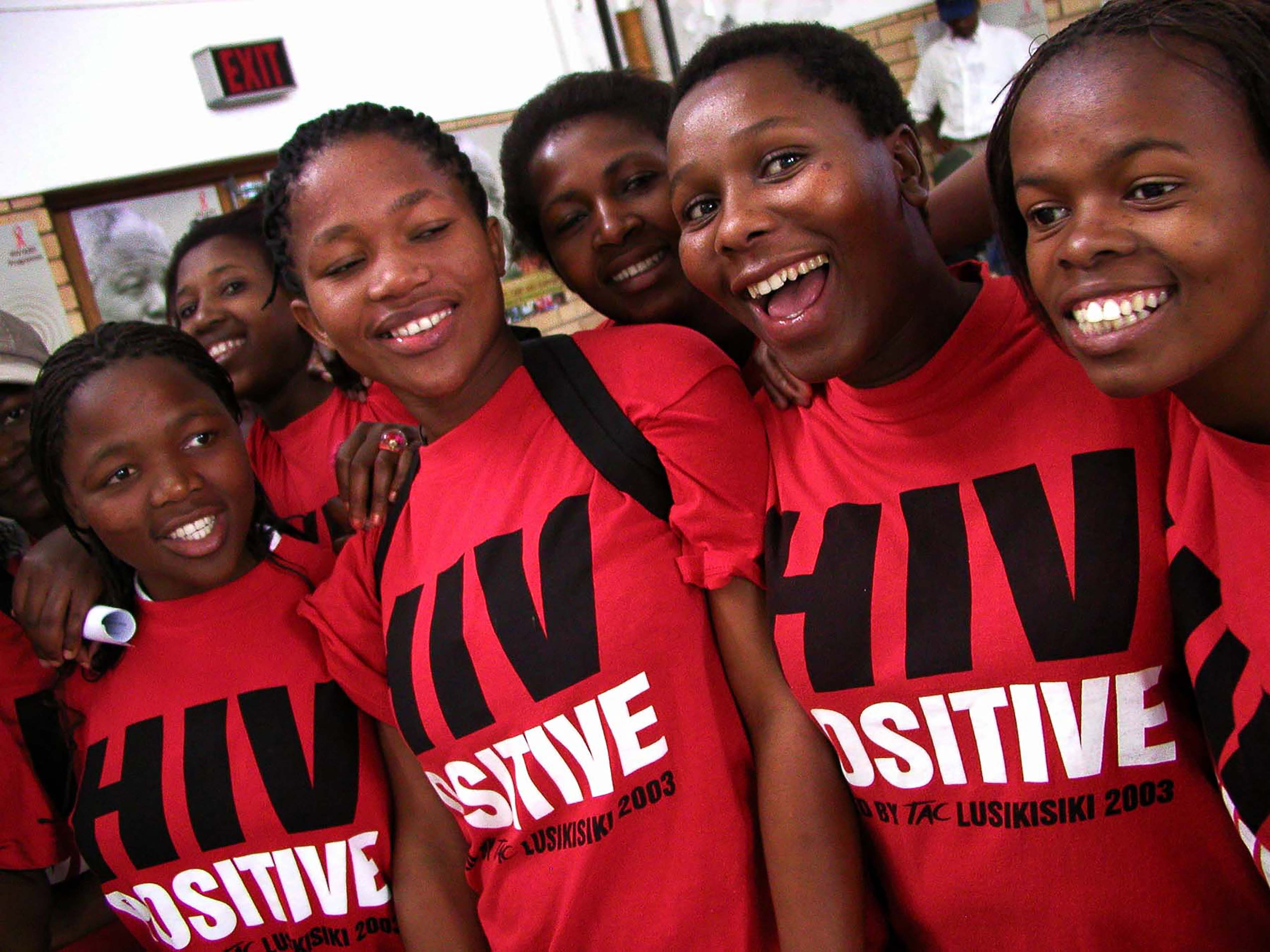 "Treatment Action Campaign (TAC) activists wear ""HIV Positive"" t-shirts during Mr Mandela's visit to Siyaphila la HIV Treatment Program hosted by MSF and the Nelson Mandela Foundation. The event was held at the Lusikiki Teacher's Training College."