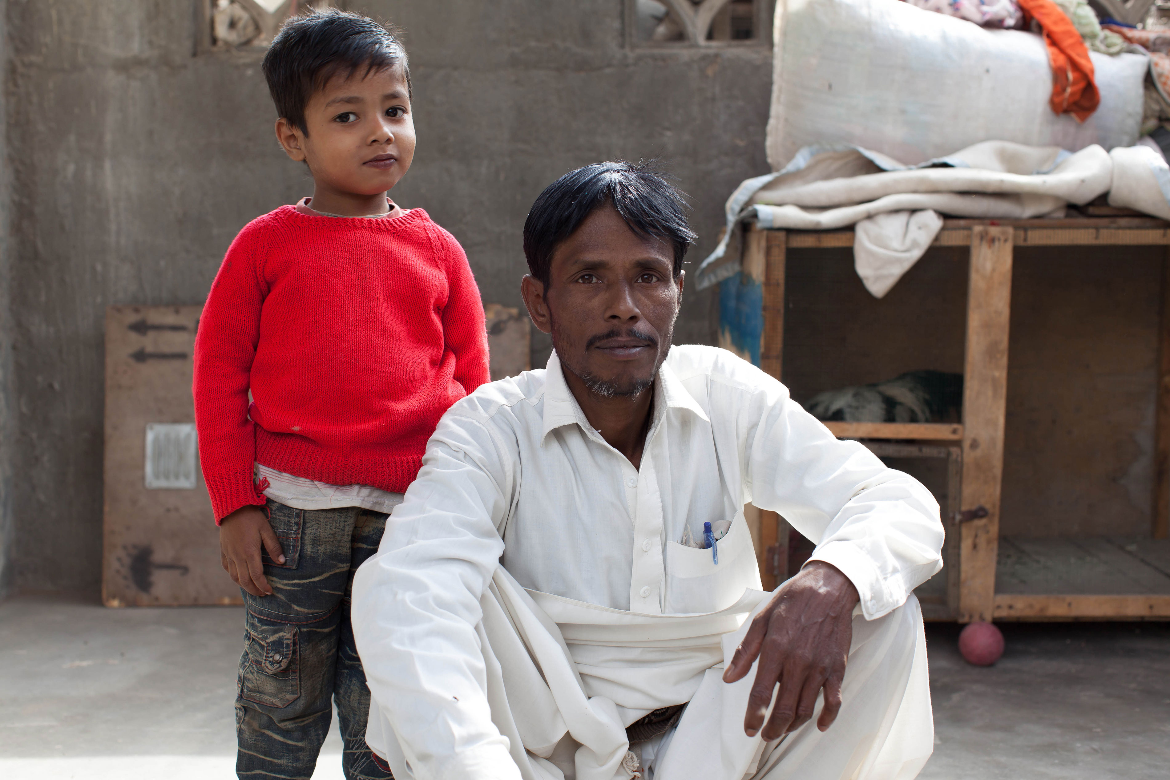 Noor Alam (pictured here with his son) was cured of Hepatitis C at MSF's Machar Clinic in Pakistan in 2016 after recieving a generic version of sofosbuvir. Gilead has priced sofosbuvir at $1,000 per pill in the U.S., despite the fact that manufacturers in India say they could produce this drug for as little as about $1 per pill.