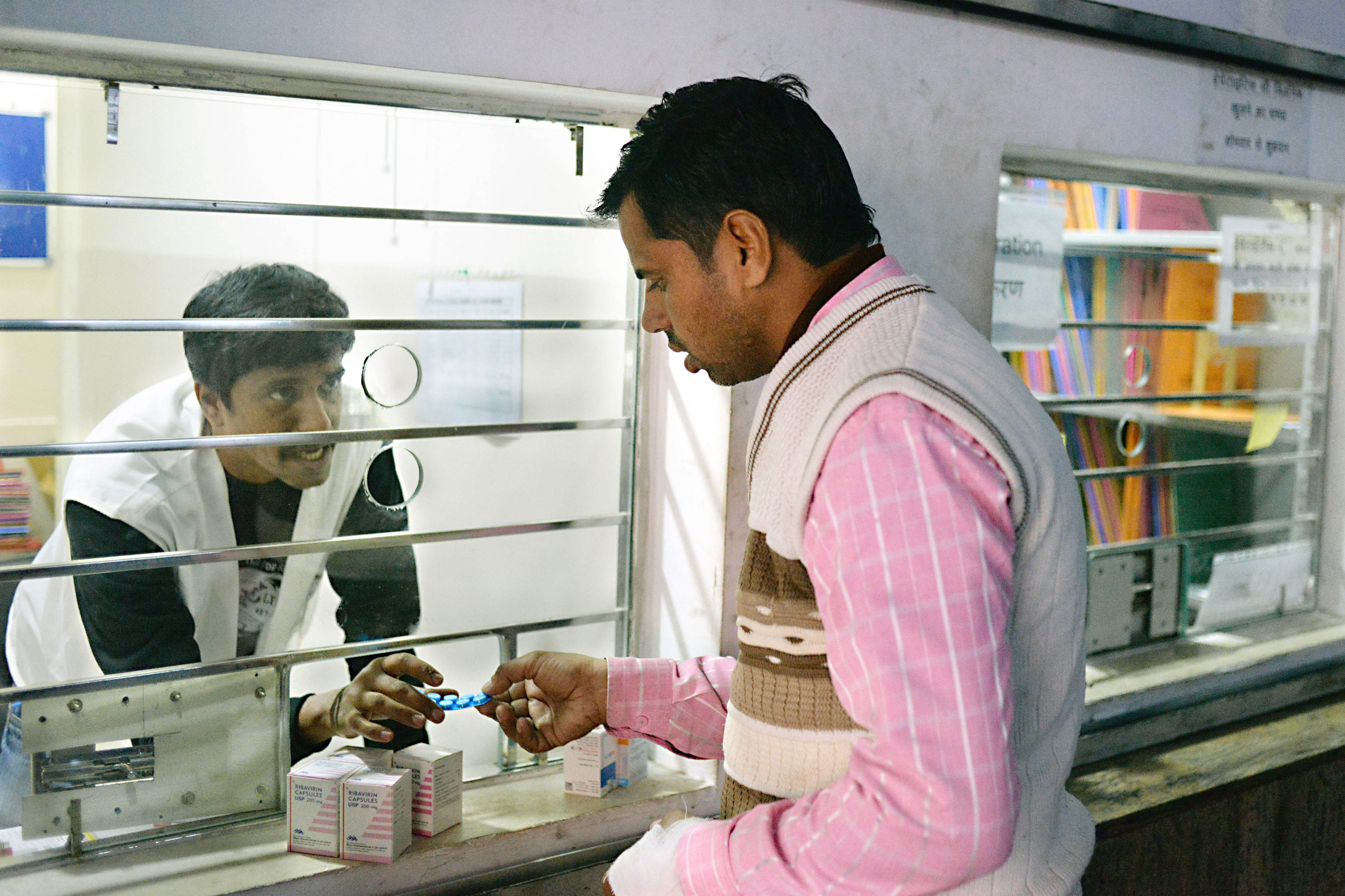 MSF Nurses Jijo Xavier dispenses drugs to a patient at MSF's hepatitis C clinic located in PL Sharma District Hospital, Meerut.