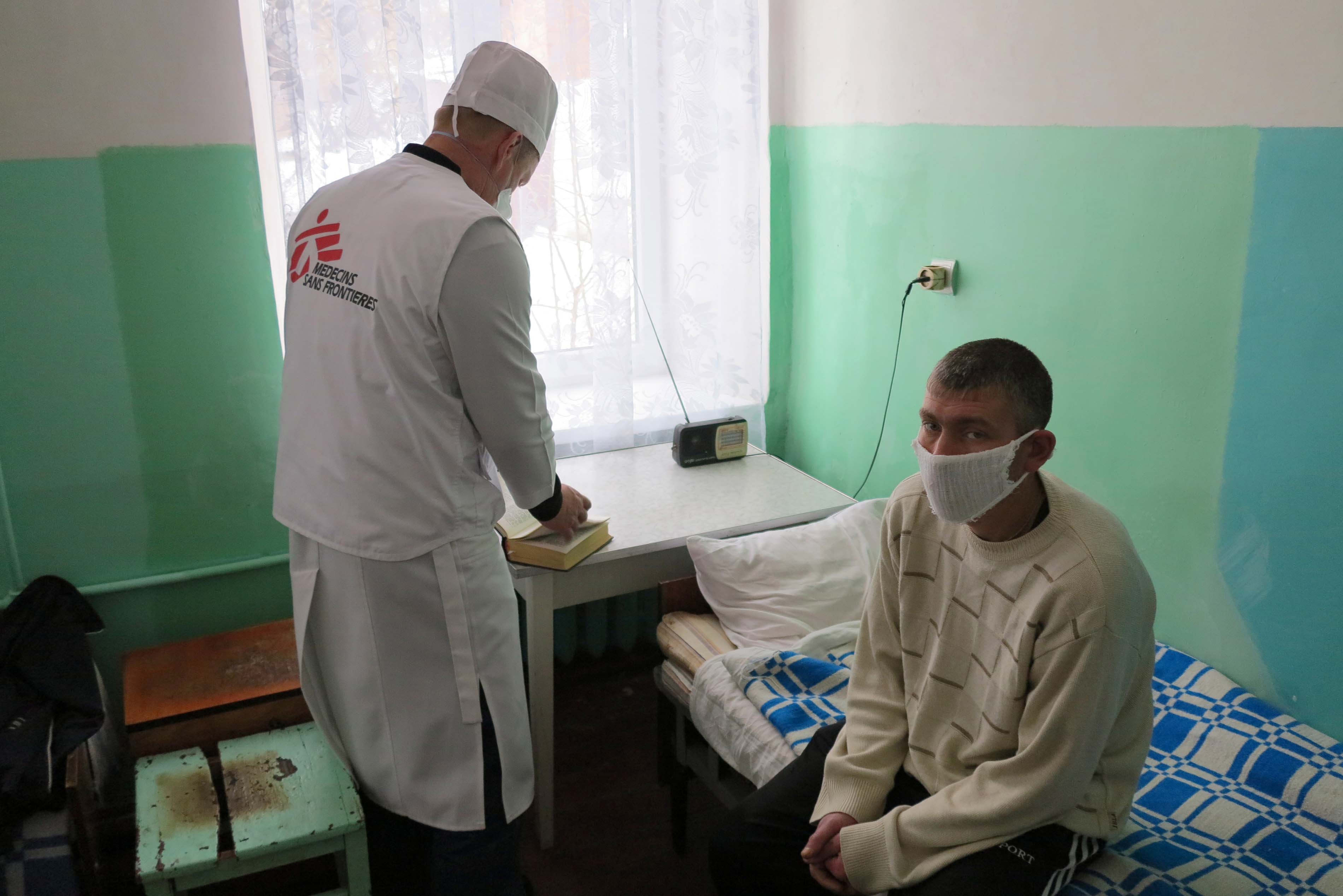 Vladimir Shalashniy, Coordinator for MSF's post-release activities, is checking up on a 31-year old patient who is staying at the Artyomovsk TB dispensary.