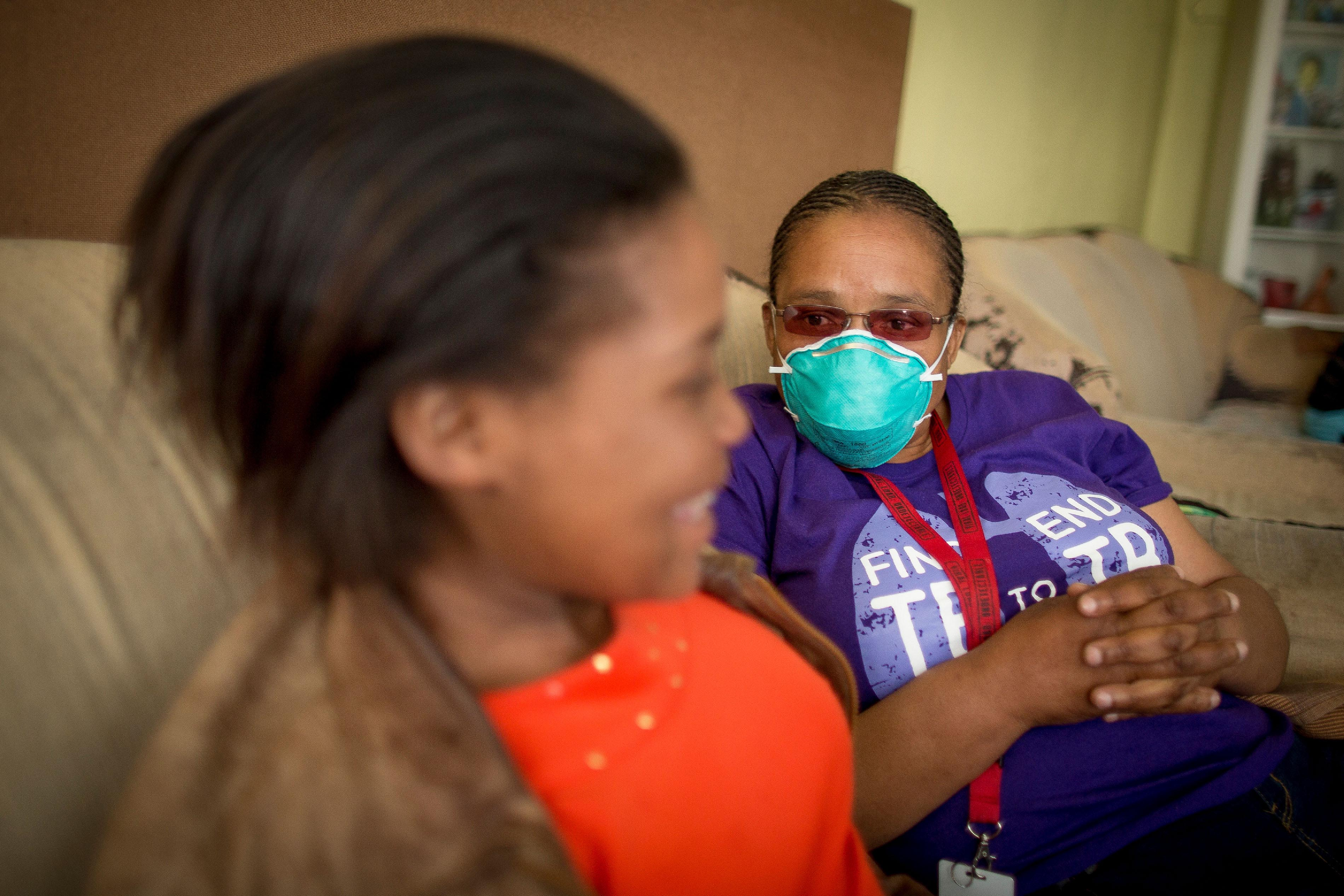 Sinethemba, 16 years,her MSF counsellor, Xoliswa, at her home in Khayelitsha, Western Cape, South Africa, where she lives with her grandmother, Vuyisiwa Madubela, and four other familtb_southafrica_sinethembawithcounselor_msf177617_sydellwillowsmith.jpg