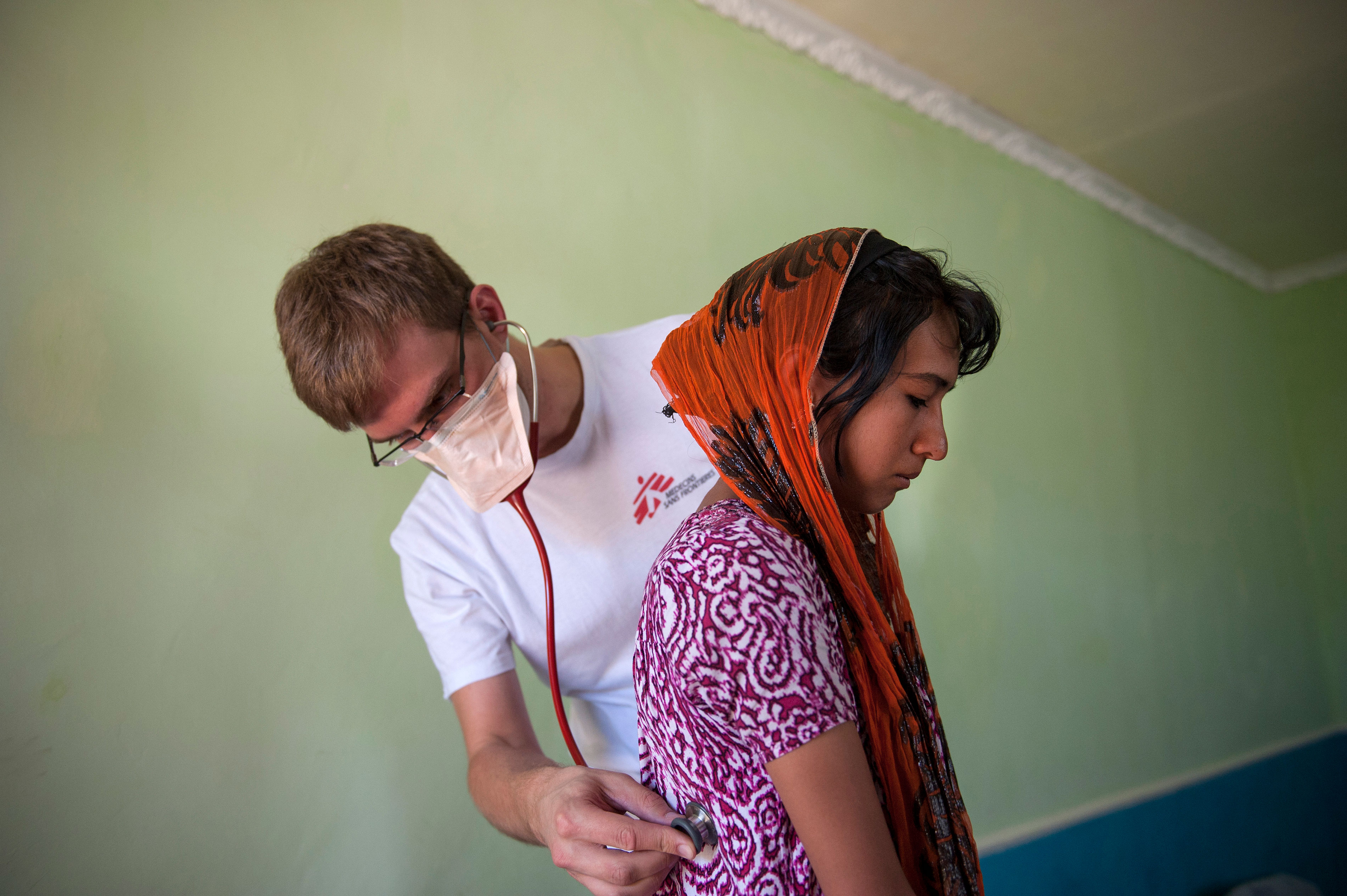 MSF doctor Christoph Höhn examines 16 year-old-Shahnoza in her family home. Shahnoza started MDR-TB treatment in October 2012 but was later diagnosed with XDR-TB. Since January 2013, she is on the right drug regimen, but she will need another 1,5 years of treatment.