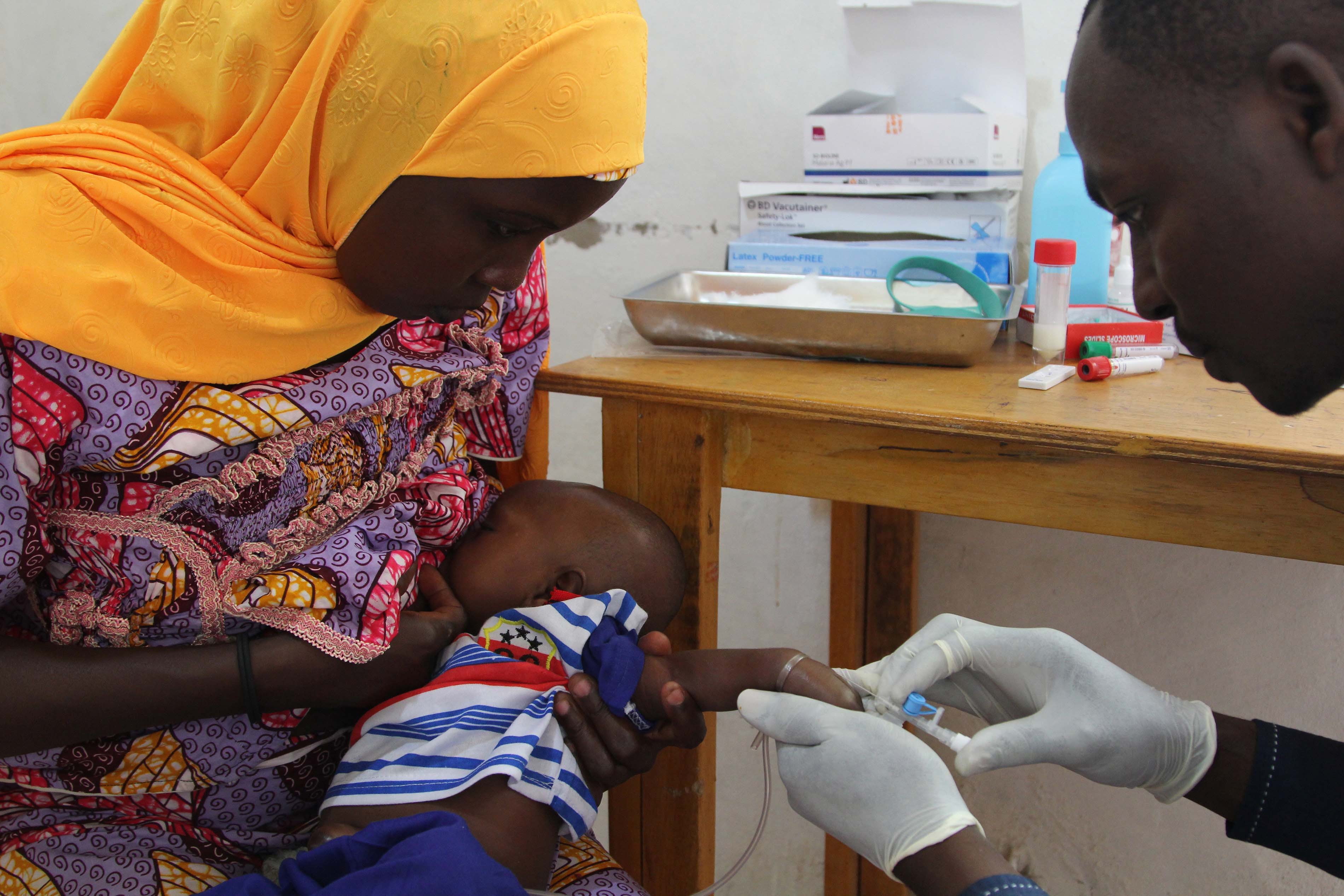 Eight-week-old Mohamed Zakari receives his first dose of the oral rotavirus vaccine (or the placebo). Eight weeks is the cut-off age. If Hadiza had come one day later, they would have had to be excluded from the clinical trial in order to comply with the medical protocol. Mohamed will receive the second and third doses of the vaccine at 10 and 14 weeks, respectively. Photograph by Séverine Bonnet