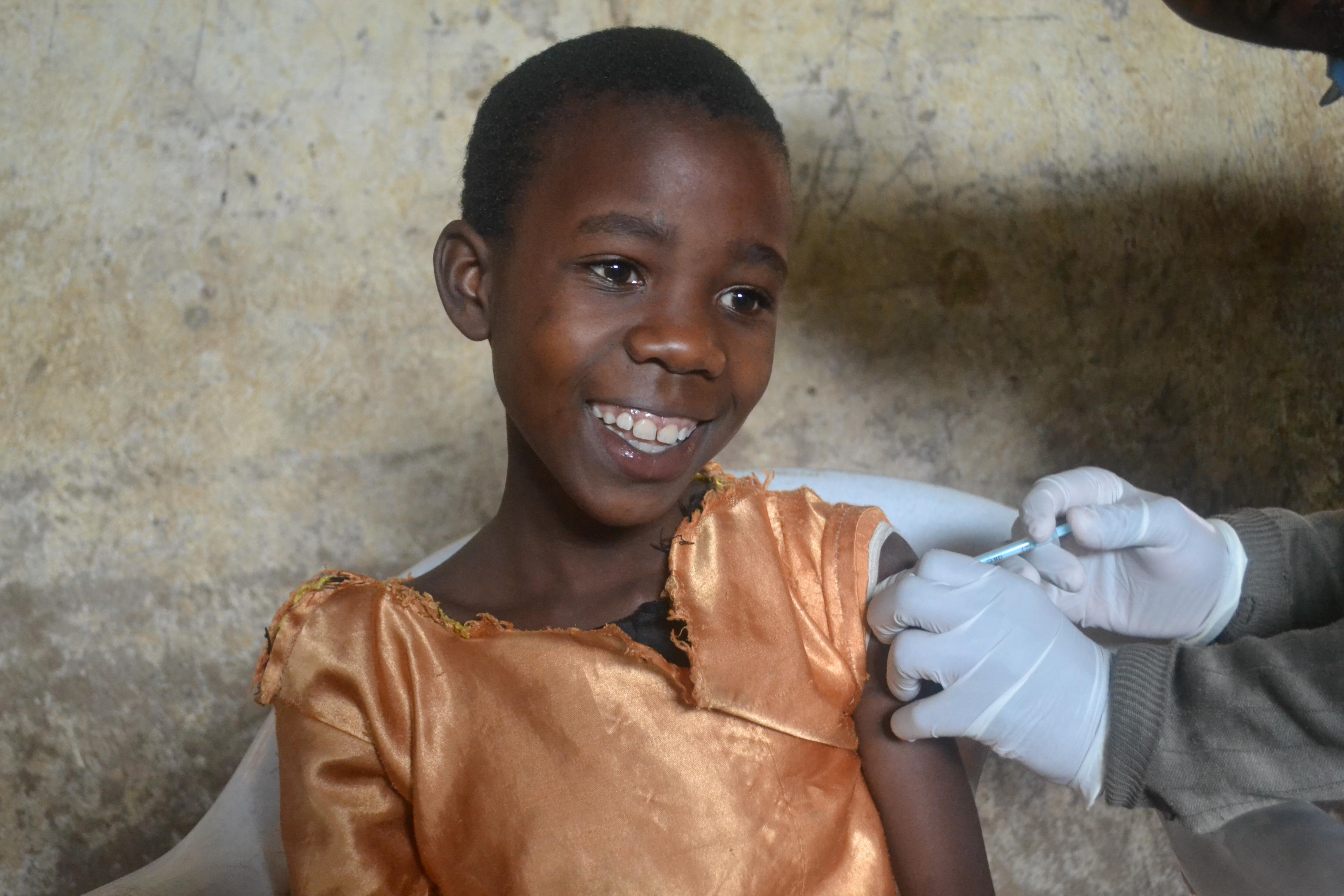 Vanessa, 9, receives her HPV vaccination at school. Chiradzulu District, Malawi.