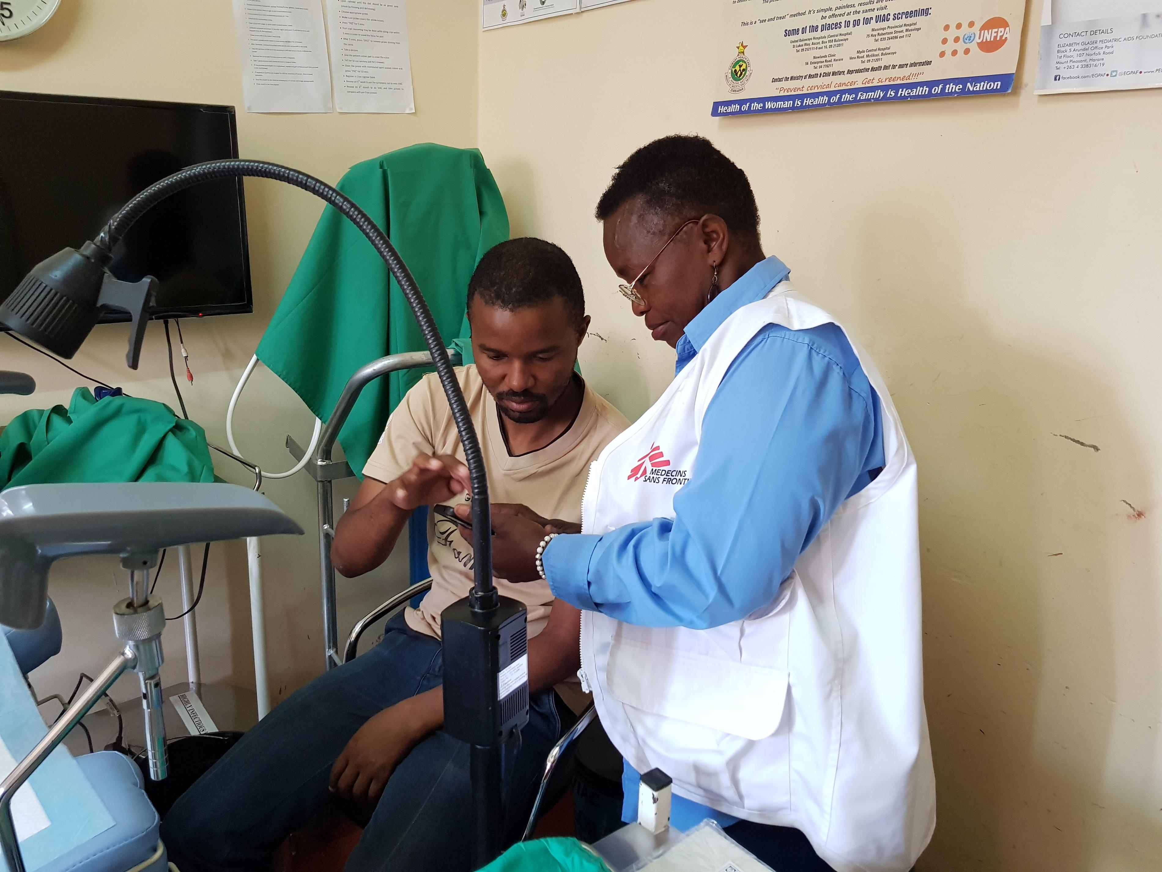 Dr Tapiwa Mupepe and MSF Nurse Mentor Sister Mercy Mandizvo reviewing a client's VIAC image before performing LEEP at Gutu Rural Hospital.