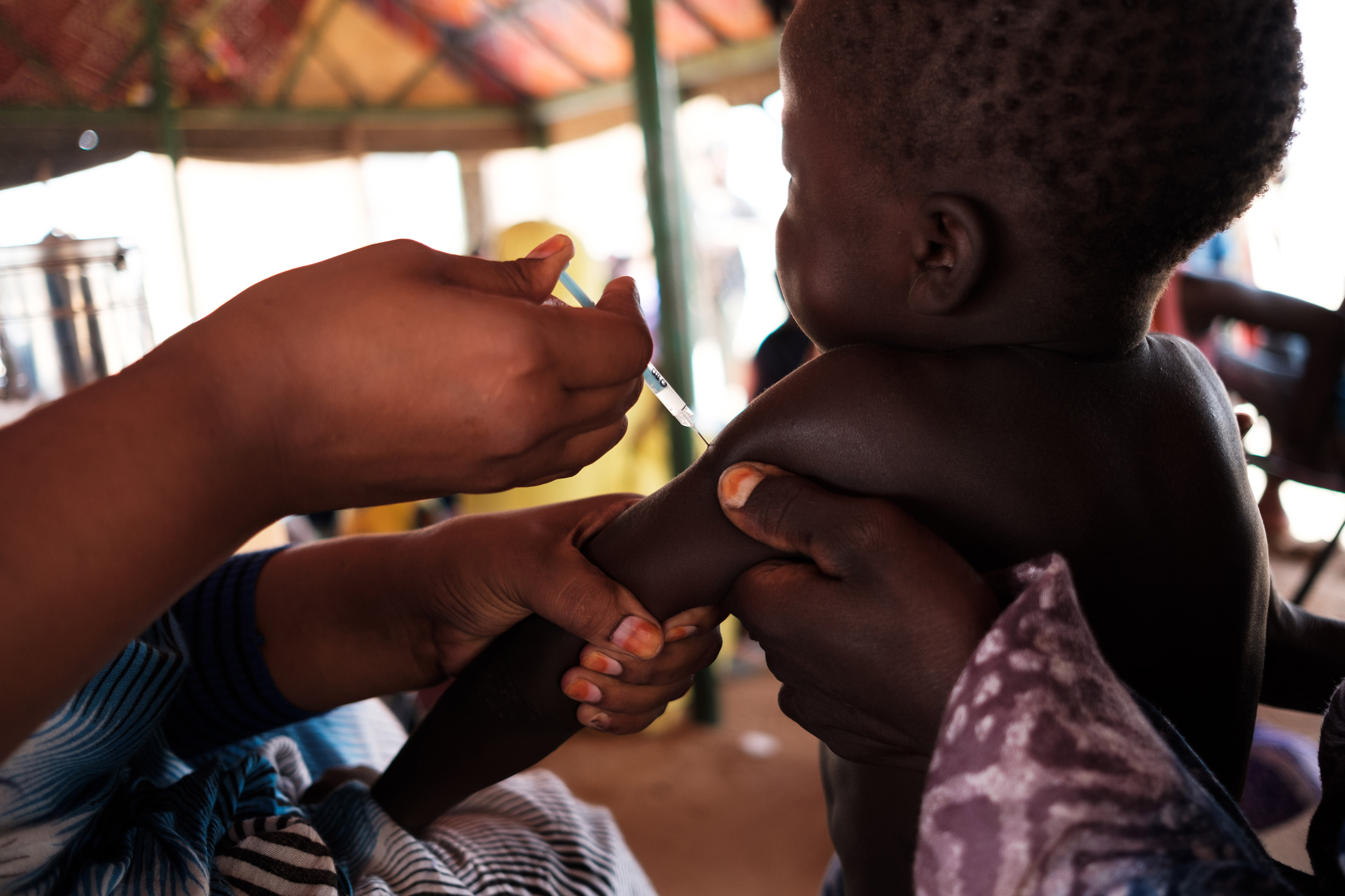 Tinelbaraka Walet Brahim being vaccinated at a homestead in the village of Lemetrewegh in the Hodh ech Chargui region of Mauritania