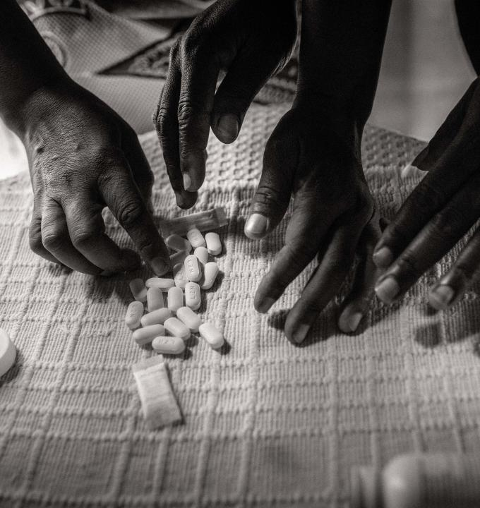 Members of CAG counting the pills. Maputo, Mozambique.