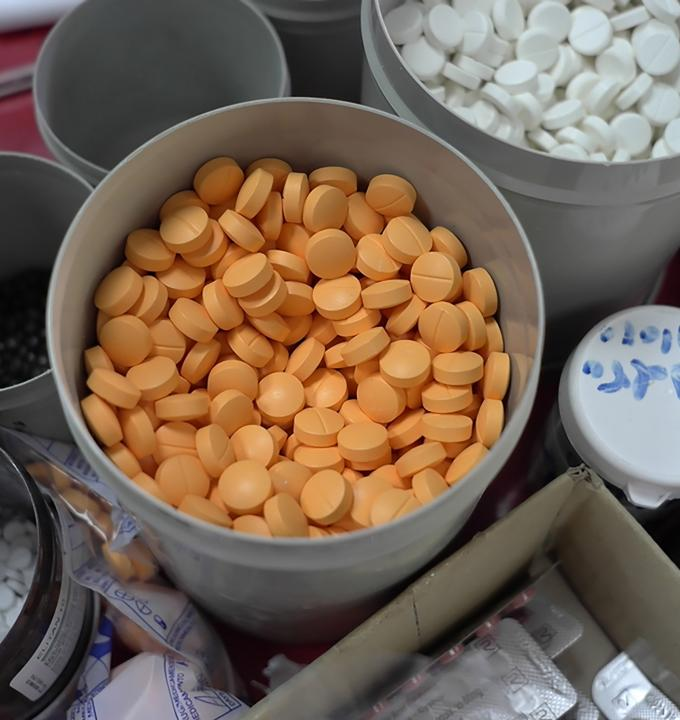 "So called ""orange pills"" (Amoxicillin), an antibiotic very popular among patients in Ahmed Shah Baba hospital in Kabul. Photograph by Doris Burtscher"