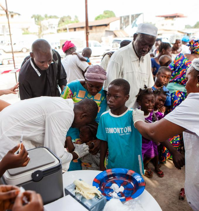 Children are vaccinated during the first day of a Measles vaccination programme in Conakry, the capital of Guinea. Photograph by Markel Redondo
