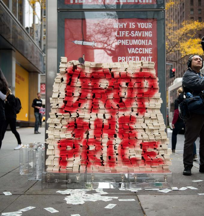 In New York, on Word Pneumonia Day 2015 (Nov 12), MSF volunteers attempted to deliver more than $17 million of fake cash - the equivalent of one day of profits from the pneumonia vaccines for Pfizer globally - to Pfizer's CEO Ian Read. The same day, MSF launched a global petition to ask Pfizer and GlaxoSmithKline (GSK) to reduce the price of the pneumococcal vaccine to $5 dollars per child (for all three doses) in developing countries. Photograph by Edwin Torres
