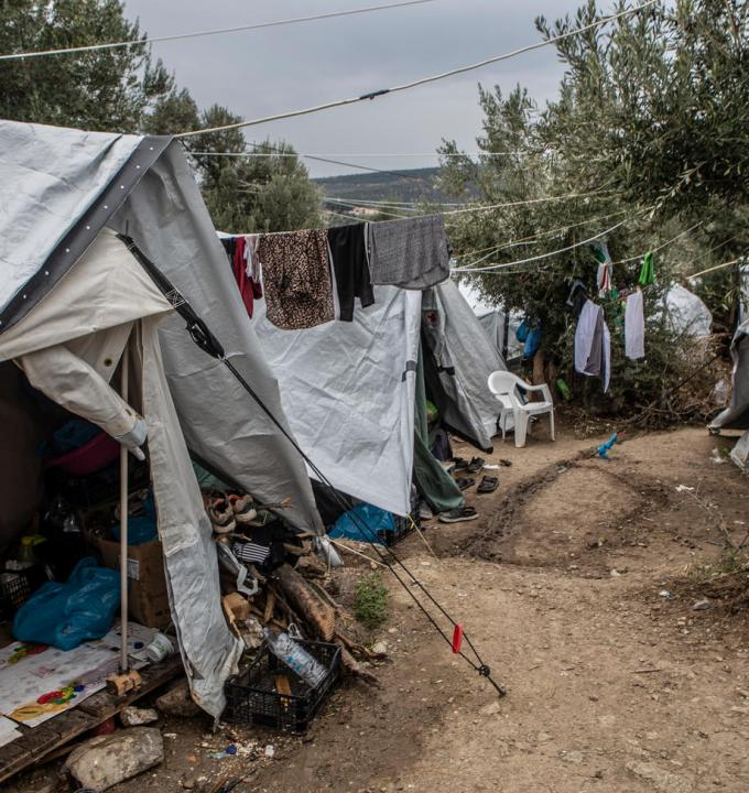 A general view of the olive grove next to the official camp of Moria. At the moment, 13,000 people stranded in a camp designed to host just 3,000. People in the olive grove have to share their tents with other people with whom, they don't have any previous relationship. The level of hygiene is very low and people have to share a toilet with another 90 people and a shower with 200. When it rains the tents are getting wet and the area turns into a muddy swamp.