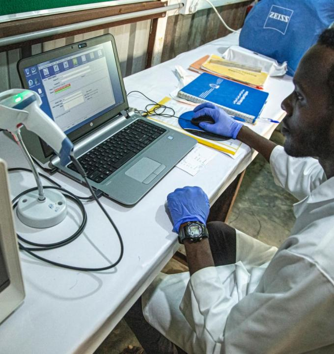 Muhanned Elnour, laboratory supervisor at MSF's hospital in Al Kashafa refugee camp, in Sudan's White Nile state, analyses data on the computer.