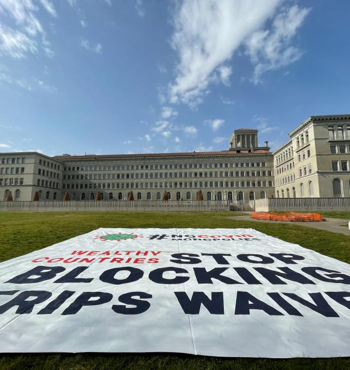Banner deployed by MSF in front of the World Trade Organization (WTO) in Geneva calling on certain governments to stop blocking the landmark waiver proposal on intellectual property (IP) during the pandemic.