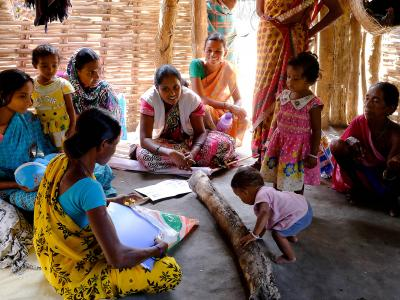A Medecins Sans Frontieres (MSF) health promoter holds a health education information session for mothers in Aragata village, Chhattisgarh, India.