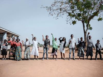 "Patients and MSF staff perform a dance to welcome new members to the ""six-months-meeting day"" in Mbulumbuzi Health Centre for the Adolescent HIV project in Malawi, it also monitors all the girls and boy who have already joined the program."