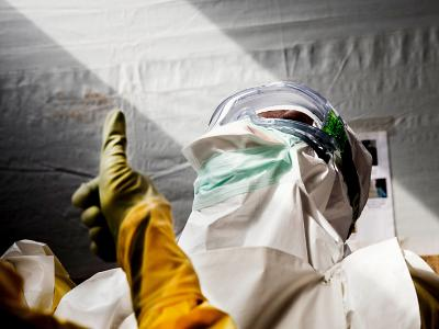 Nurses check each other's PPE as the prepare to enter the high-risk zone in MSF's Ebola treatment center in Sierra Leone.