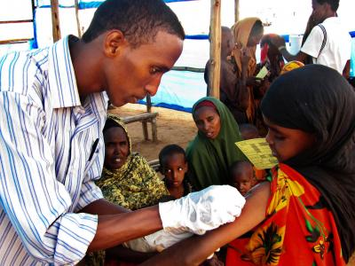 Measles vaccination. Some six hundred under-15s are vaccinated every day at the transit camp. Coupled with high levels of malnutrition, measles can be fatal.