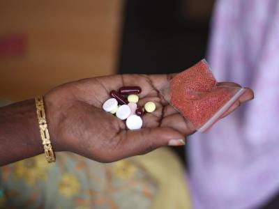 Shanti (name changed) is a 38 year old semi-literate woman living in Mumbai. She has been living with HIV and multidrug resistant tuberculosis (MDR-TB) for the past 5 years. Here, she displays her daily dosis of medication. Photograph by Bithin Das