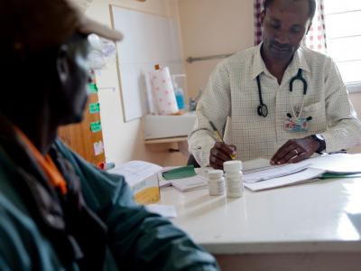 MSF treats more than 200,000 people worldwide for HIV and 97 percent of the antiretrovirals are quality, affordable generics from India. Here, an MSF doctor in Kenya consults one MSF's thousands of HIV+ patients under treatment.
