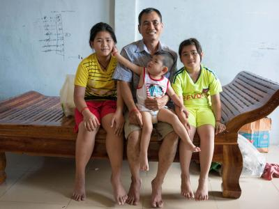 Din Savorn, 50, poses with his children at his apartment in Phnom Penh, Cambodia, 20, April 2017.