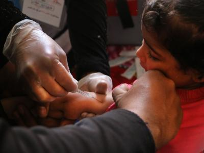 A nurse vaccinates a young Syrian girl against measles and pneumonia in Al-Atareb, Syria. MSF conducted a vaccination campaign targeting tens of thousands of children in partnership with the Syrian Immunization Group and Health Directorate of Aleppo, Syria. -Al-Atareb-14-4-2018 Roaa Hasan.