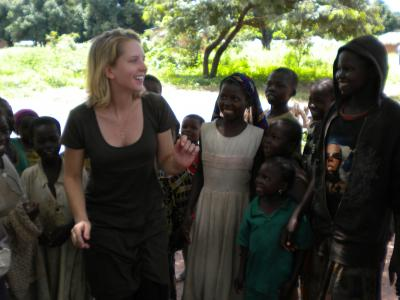 MSF nurse Kathryn Sisterman teaches children in Maitikoulou a song about sleeping sickness in their native language, Mbai.