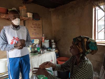 Celumusa Hlatswako, an MSF mobile counsellor, visits Winile, an XDR-TB patient, at home in Manzini Region, Swaziland.