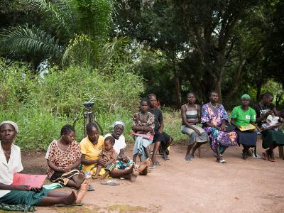A group of ladies sit waiting for consultations, or to see the MSF medical doctors at an MSF mobile clinic site in Bodo, a village just outside Yambio, in Gbudwe State, South Sudan. Photograph by Charles Atiki Lomodong