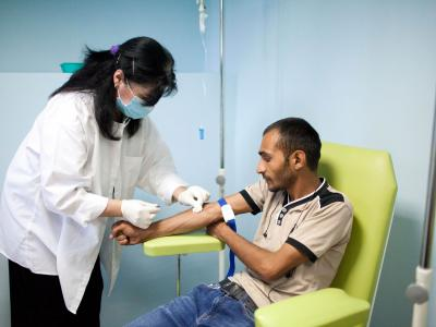 Goderdzi Rajabishvili, an ambulatory patient at the National Centre for Tuberculosis and Lung Disease in Georgia's capital, Tbilisi, receives his twice-daily infusion of imipenem, an antibiotic used to treat MDR-TB.