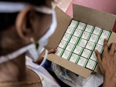 Nischaya, an XDR-TB patient, looking at her TB medication at the MSF clinic in Mumbai. Photograph by Atul Loke