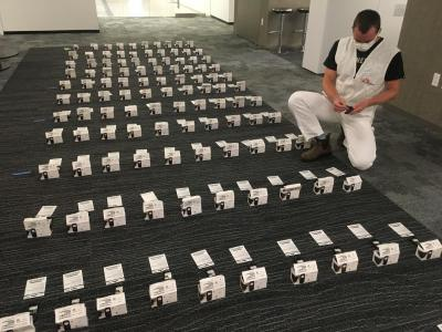 MSF Logistician Eric Schimdt prepares dozens of cellphones for distribution. MSF's COVID-19 team in New York City is distributing 1,000 cellphones to people who are currently homeless and housing insecure so they can contact emergency, medical and social services.