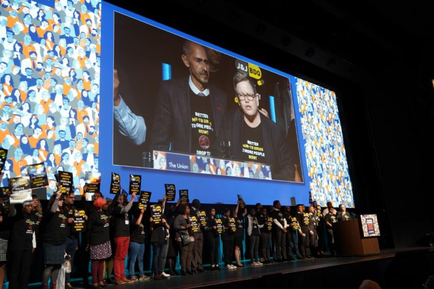 Activists interrupt TB conference opening ceremony to call on J&J to cut price of TB drug in half, to one dollar per day
